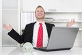 Successful businessman laughing with hands up and laptop Royalty Free Stock Photo