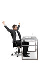 Successful businessman raising hands up looking at laptop and laughing isolated on white background Royalty Free Stock Image