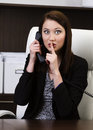 Successful businesswoman gesturing keep silence portrait of attractive young business woman sign while talking on phone in the Stock Photos