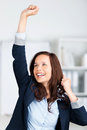 Successful businesswoman raising her hands inside the office Stock Images