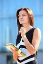 Successful businesswoman taking notes or entrepreneur while walking outdoor city business woman working Royalty Free Stock Photo