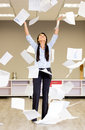 Successful businesswoman throwing papers Stock Image