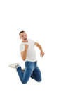 Successful casual man jumping - isolated over a white background