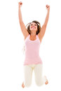 Successful casual woman with arms up isolated over white background Royalty Free Stock Photo