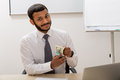 Successful clerk received a salary manager keeps wad of money Royalty Free Stock Photography