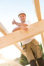 Successful in the construction business young builder is proud about his project Royalty Free Stock Images
