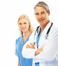 Successful doctor with hands folded  and nurse Stock Images