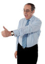 Successful entrepreneur gesturing thumbs-up Royalty Free Stock Photography