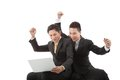 Successful excited business colleagues looking at the laptop screen Royalty Free Stock Image