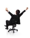 Successful excited business man sitting in chair back view of young businesspeople smile raised hands arms isolated over white Royalty Free Stock Photos
