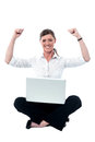 Successful female manager studio shot happy and businesswoman with her arms raised up Royalty Free Stock Image