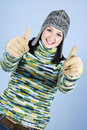 Successful girl in wool sweater give thumbs Stock Photos