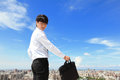 Successful handsome business man with blue sky and city background mode is a asian male Stock Photo