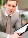 Successful handsome business man holding a folder Royalty Free Stock Photo