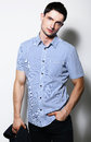 Successful handsome stylish young man in blue shirt standing fashionable male studio Stock Photo