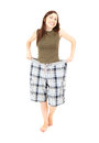 Successful losing weight, girl in big trousers Stock Photography