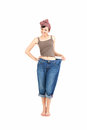 Successful losing weight - woman in big trousers Royalty Free Stock Images