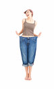 Successful losing weight - woman in big trousers Royalty Free Stock Photo