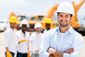 Successful male architect at a building site with arms crossed Royalty Free Stock Photography