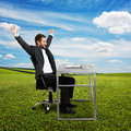 Successful man raising hands up businessman looking at laptop and laughing photo at outdoor Stock Photography