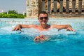 Successful man relaxing in pool jacuzzi outdoor at spa resort enjoying luxury life success healthy lifestyle body care concept Stock Photos
