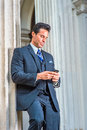 Successful Middle Age American Businessman Texting Outside Vintage Office In New York