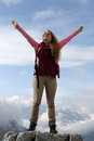 Successful mountaineer on top of a mountain enjoying freedom in the mountains Royalty Free Stock Images
