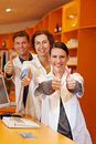 Successful pharmacists in pharmacy Stock Image