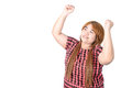 Successful plump woman punching the air with her fists in air s rejoicing raising face to sky and smiling and shouting Royalty Free Stock Photo