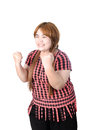 Successful plump woman punching the air with her fists in air s rejoicing raising face to sky and smiling and shouting Stock Image