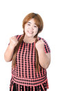 Successful plump woman punching the air with her fists in air s rejoicing raising face to sky and smiling and shouting Royalty Free Stock Images