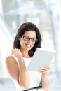 Successful reading on digital tablet woman holding businesswoman using internet device and smiling professional success concept Stock Image