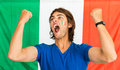 Successful sportsman shouting in front of italian flag young fan the team standing an supporting his team with clenched fist and Stock Photography