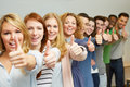 Successful students holding thumbs Royalty Free Stock Photography