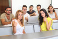 Successful students holding thumbs up in the university Stock Image