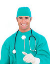 Successful surgeon holding surgical forceps Stock Photography