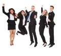 Successful welldressed businesspeople with arms raised full length portrait of standing over white background Stock Image