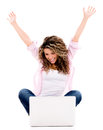 Successful woman with a laptop computer and arms up isolated over white Royalty Free Stock Image