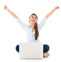 Successful woman online with arms up and a laptop isolated over white Stock Photo