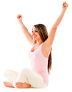 Successful woman smiling with arms up isolated over a white backgorund Royalty Free Stock Photography