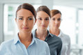 Successful women entrepreneurs posing business standing and smiling at camera empowerment and determination concept Stock Images