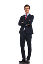 Successful young business man standing with hands crossed Royalty Free Stock Photo