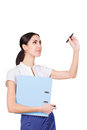 Successful young business woman in formalware with documents and pen writing. Isolated Royalty Free Stock Photo