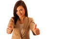 Successful young business woman showing thumbs up as a gesture for success isolated over white Royalty Free Stock Images