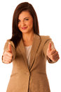Successful young business woman showing thumbs up as a gesture for success isolated over white Stock Image