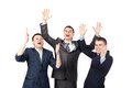 Successful young businesspeople raising hands Royalty Free Stock Image