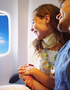 Successful Young couple sitting in a plane. Royalty Free Stock Photography