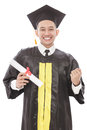 successful of young graduation man smiling while holding diploma Royalty Free Stock Photo