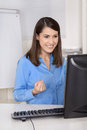 Successful young smiling business woman sitting in her office happy Royalty Free Stock Images