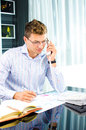 Successfull young business man speaking on the phone Royalty Free Stock Photography